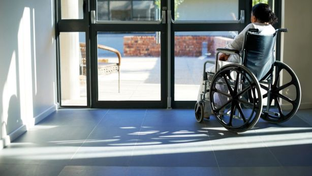 Heavy, manual doors in apartment buildings are difficult for people in wheelchairs to use. Photo: iStock