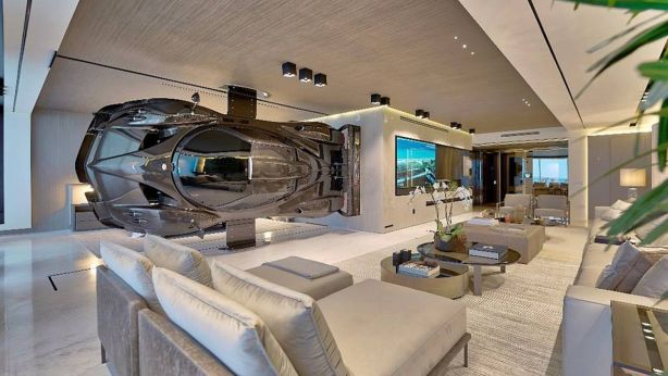 The car as art - mounted sideways, this $2.1m Pagani Zonda R sportscar forms a partition between the master suite and living room in this high-end Miami condo. Photo: Finish My Condo
