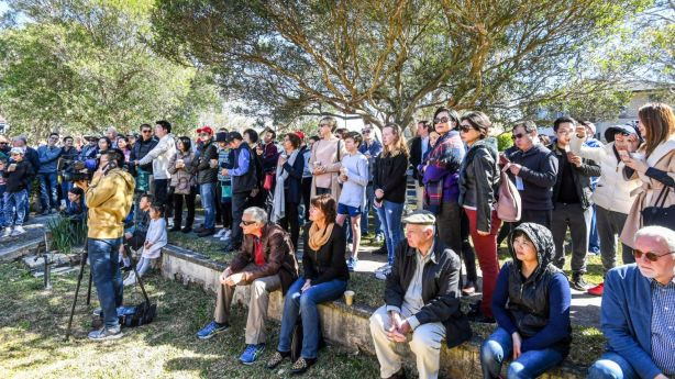 More than 100 people turned out to watch the home go under the hammer on the first day of spring. Photo: Peter Rae.