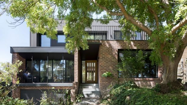 After: Architects convinced the owners to reinvent the existing brick house. Photo: Tatjana Plitt