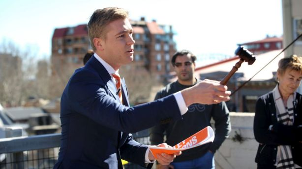 Auctioneer Jake Moore in action at the auction of 9/13-17 Hughes St, Potts Point. Photo: James Alcock