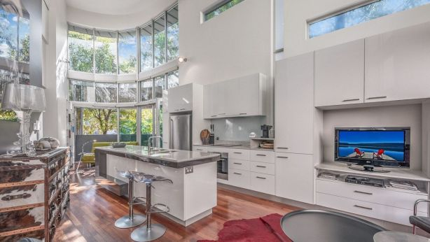 Stunning use of glass gives natural light at townhome 15/20, corner of Newstead Terrace and Austin Street, Newstead. Photo: Style Estate Agents