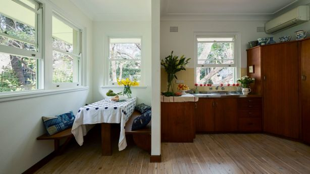The kitchen retains its original cabinetry, floors and a dining nook with bench space for the family of six. Photo: Supplied