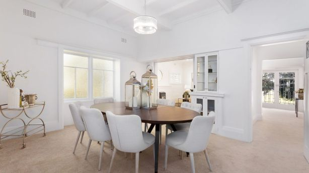 Inside are lofty ceilings, hand-crafted leadlight entry doors and leadlight windows. Photo: Supplied