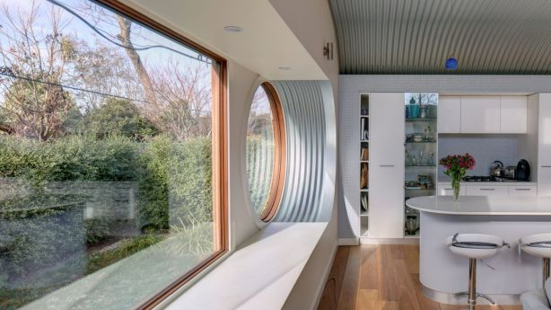 The extension showcases a consistent harmony of flooring, joinery and lighting. Photo: Brett Boardman