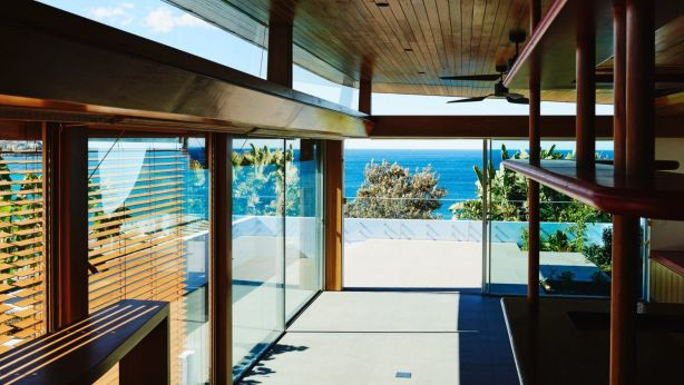 The two-storey property is designed with a north-east aspect overlooking the beach and ocean. Photo: Supplied