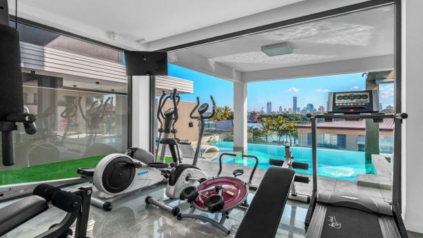 The gym overlooking the pool, the Brisbane River and the city at 53 Wendell Street, Norman Park.