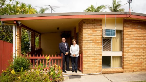 Real Estate agent Mark White and Sandra Joyce at 47 Chermside Road, Mango Hill, which go to auction with no reserve on September 15.