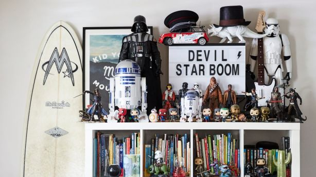 Merging bookshelves creates a new family narrative, housed in Ikea bookshelves. Photo: Caitlin Mills