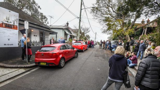 About 50 people gathered in the cul-de-sac to watch the property go under the hammer. Photo: Peter Rae.