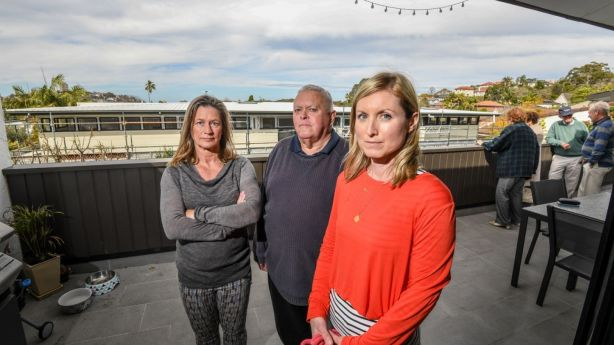Residents Ruth Goodall, Brian Hallet and Ainsley Johnstone, pictured on the deck of one of the Balgowlah units that has lost its water views. Photo: Peter Rae