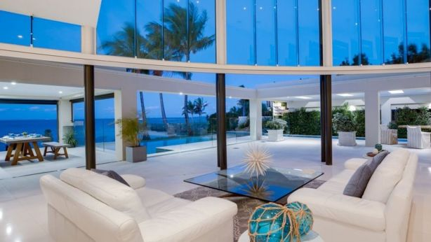 The entire back of the house at 8 Sentinel Court, Raby Bay, opens up to the outdoors and the ocean.