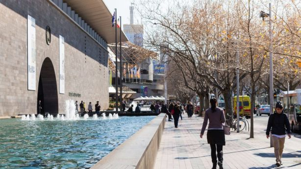 People enjoying a walk near the National Art Gallery Victoria on St Kilda Road. Photo: Greg Briggs