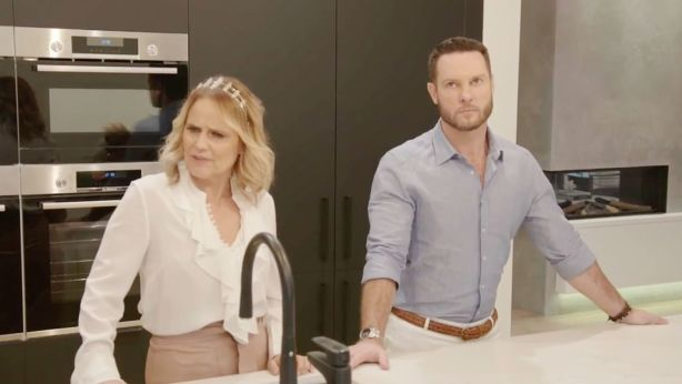Shaynna and Darren in Sara and Hayden's kitchen. In the spirit of this episode's bad blood, Darren is thinking about everyone who has ever crossed him. Photo: Channel Nine/The Block