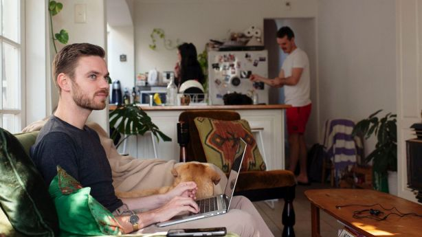 Patrick Morrow, with his dog and housemates, says the new rental laws are a relief. Photo: Christopher Pearce