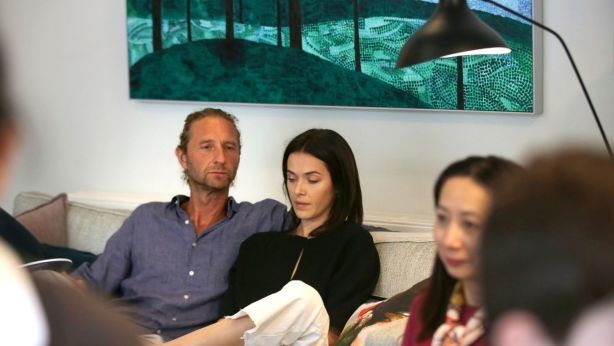 Justin Hemmes and his former partner Kate Fowler at the auction of Michael Miller's Bellevue Hill property. Photo: James Alcock