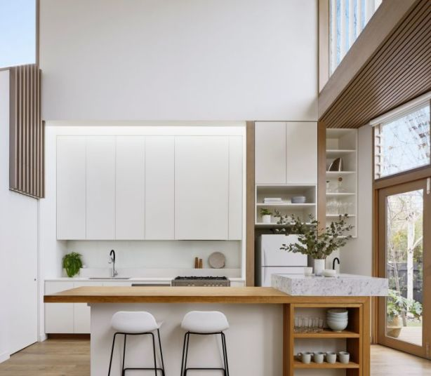 The kitchen has incredible visual access to the sky from a double-height void. Photo: Tatjana Plitt