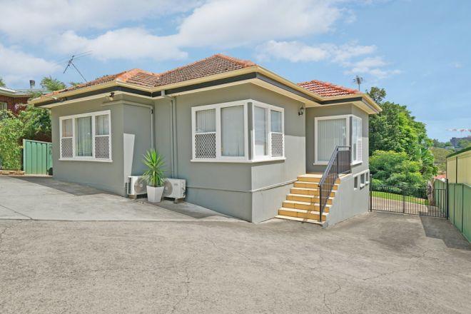 32 Hilltop Cres, Campbelltown NSW 2560
