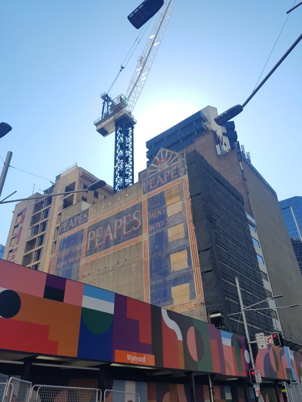 Another old painted sign briefly reappears on a Sydney building during demolition for new Wynyard Place development