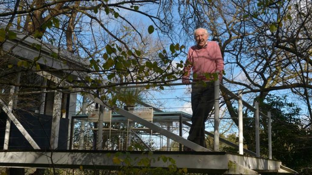 McIntyre on the cantilevered balcony of River House in Kew.