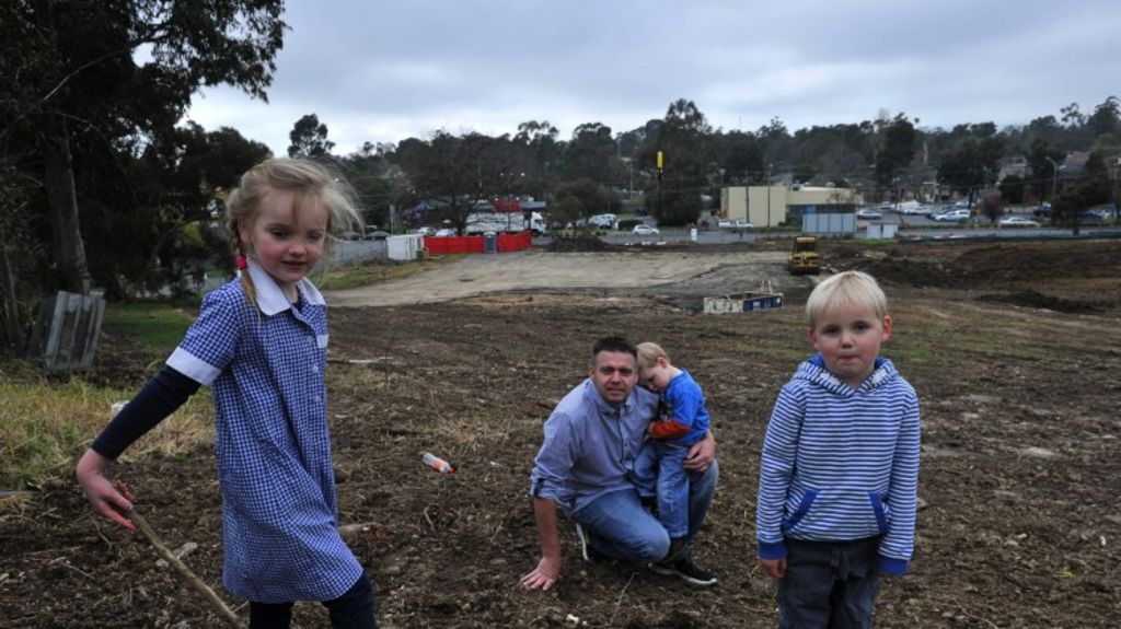 Different times: Cameron Patchett searches the former Mooroobark Primary School for a time capsule, aided by his children Shayla, Koby and Jesse. Photo: Michael Clayton-Jones