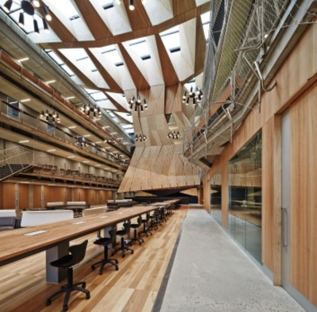 The designs eschews traditional classrooms and replaces them with long desks and open corridors. Photo: Peter Bennetts