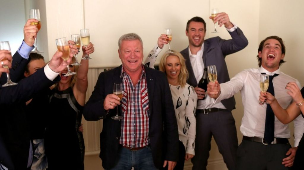 Champagne flows as the contestants celebrate an incredible night of frenzied auctions. Photo: Pat Scala