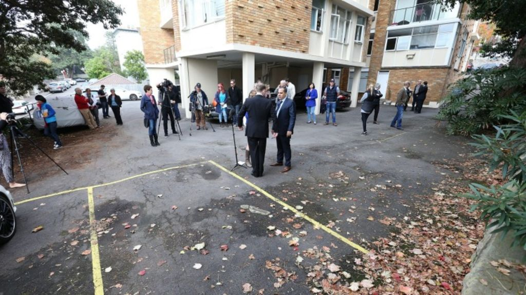 A crowd gathers at auction of a car spot at 29 Carabella Street, Kirribilli, on Saturday. Photo: Anthony Johnson