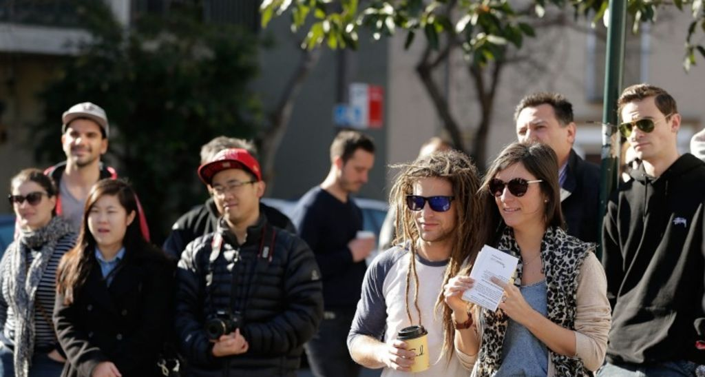 A young crowd of 60 gathered for the auction at 31 McDonald Street, Erskineville. Photo: Mark Metcalfe