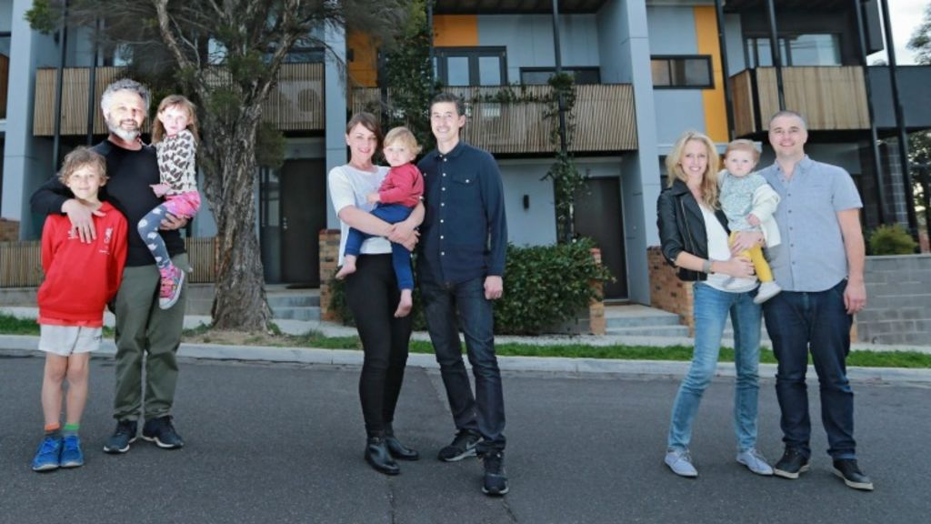 These three young families pooled their cash to develop four new townhouses. Dan (left) with kids Elke 5 & Elias 9, Tim & Kim (centre) with baby Orson 19 months and Andrew & Tanya (right) with baby Aurelia 15 months. Photo: Wayne Taylor