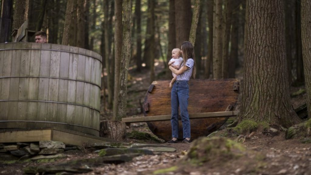 Courtney Klein holds Nell Klein at the wooden hot tub. Photo: Theresa Ambrose, New York Times
