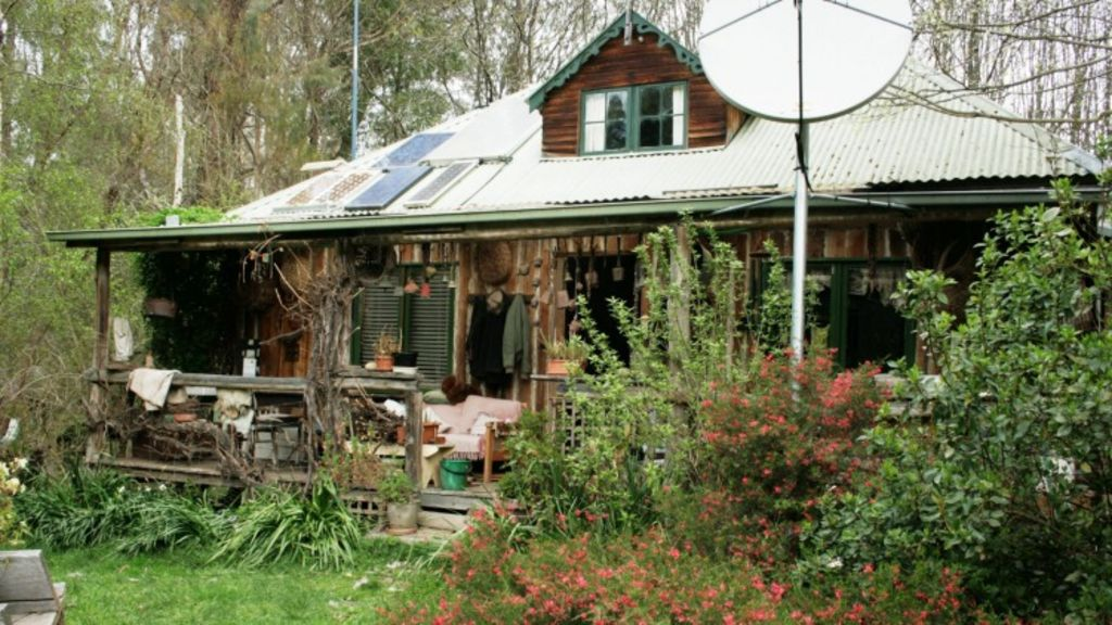 Jill Redwood's home, built from salvaged sleeper offcuts and poles from the nearby forest.