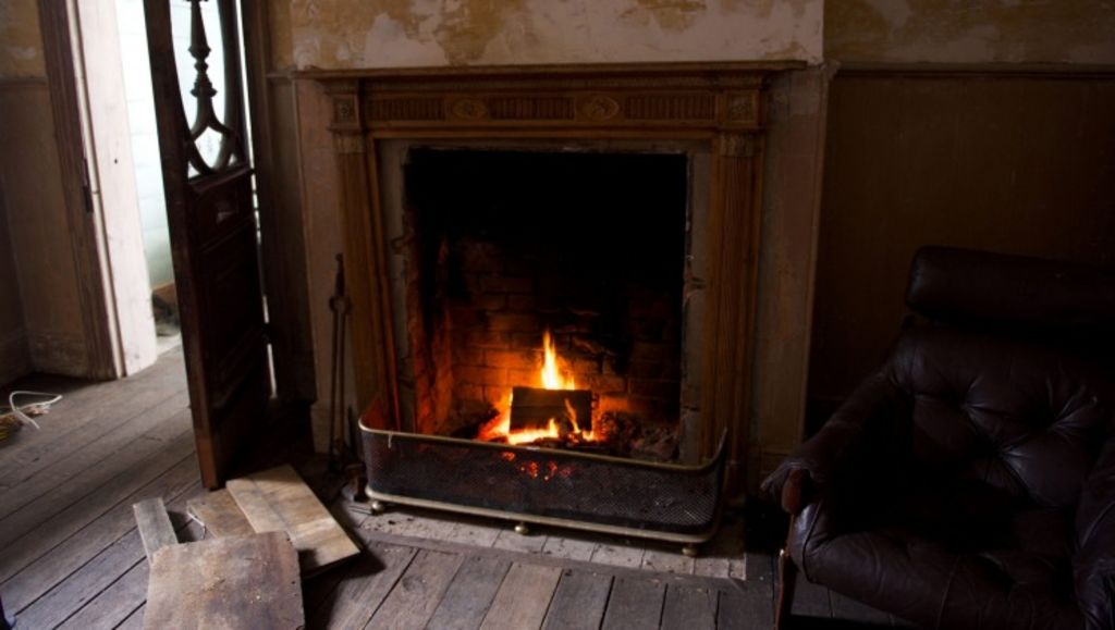 An open fireplace inside the Harrington Street house in Hobart. Photo: TONESTER
