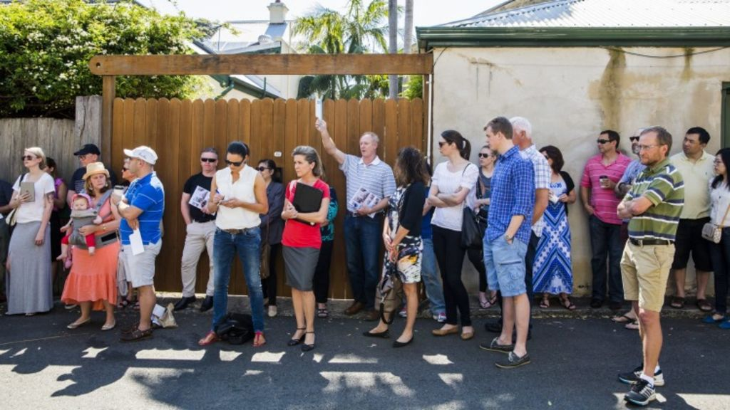 Heated bidding at the auction of ABC presenter Leigh Sales' townhouse at 1/10 Jarocin Avenue, Glebe. Photo: Anna Kucera
