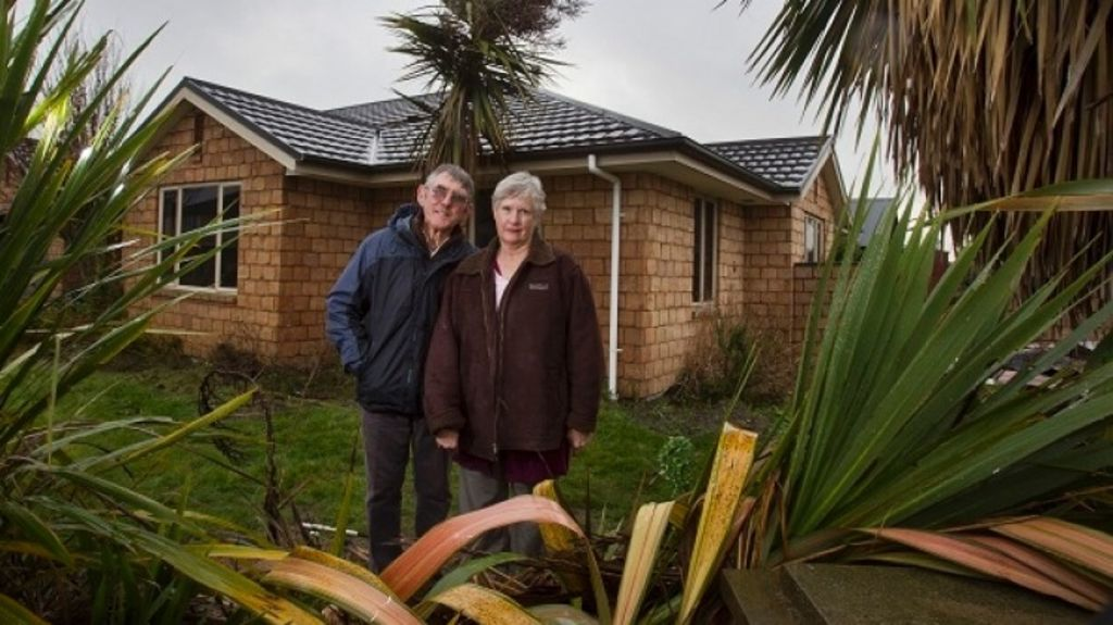 Phyllis and Michael Thom at their red-zoned house to be auctioned with $1 reserve. Photo: John Kirk-Anderson/FairfaxNZ