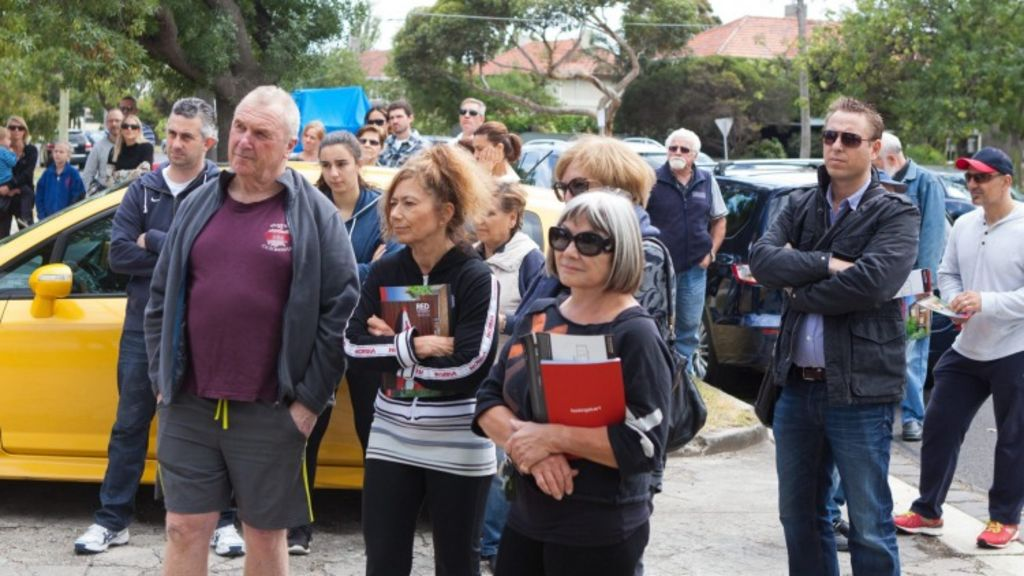 Onlookers at the auction of 45 Beacon Road, Port Melbourne, on Saturday. Photo: Alistair Walsh