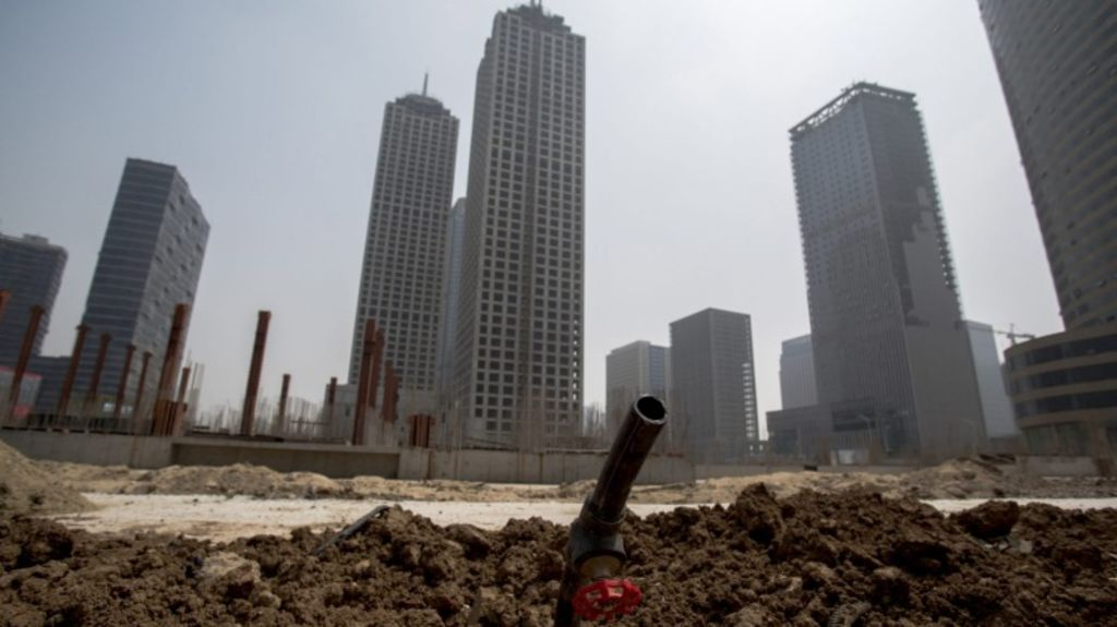 Unfinished buildings and deserted construction site in Xiangluo Bay. Photo: Zhang Peng