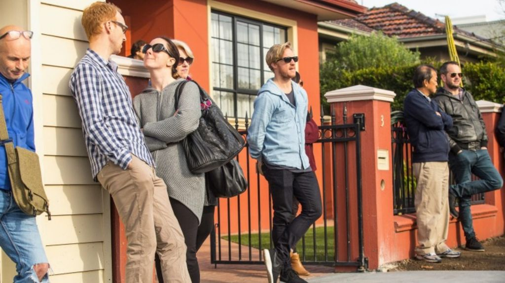 Young buyers wait for an auction in Seddon in Melbourne's west. Photo: Chris Hopkins