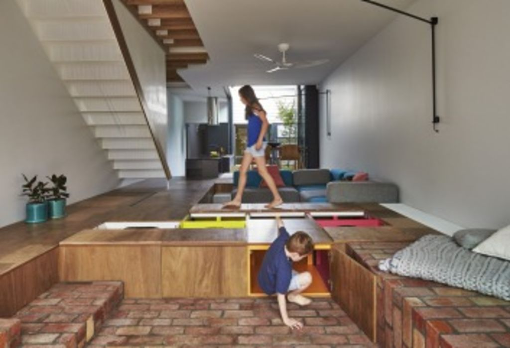 At Mills House, architect Andrew Maynard designed an addition that includes a floor that doubles as a giant toy box. Photo: Peter Bennetts