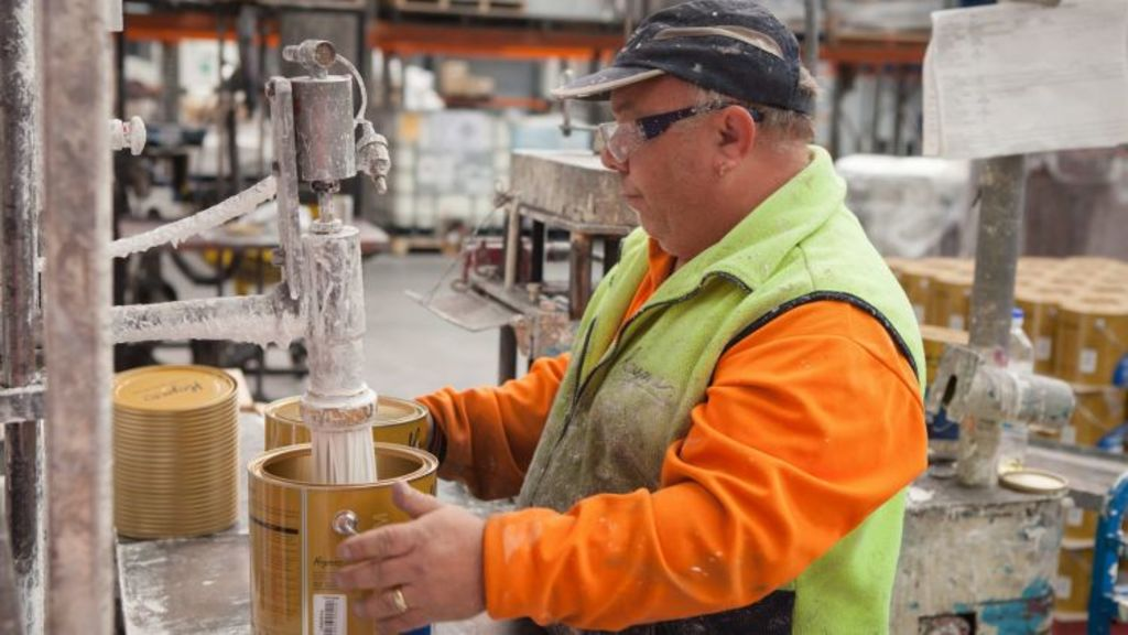 Right mix: A Haymes paint factory worker fills the can. Photo: Alistair Walsh