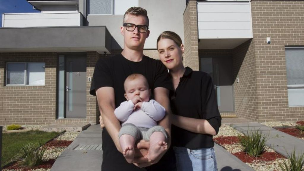 Brett and Emma Rule-Layton are determined son won't grow up in one of Melbourne's thousands of small apartments. Photo: Simon O'Dwyer