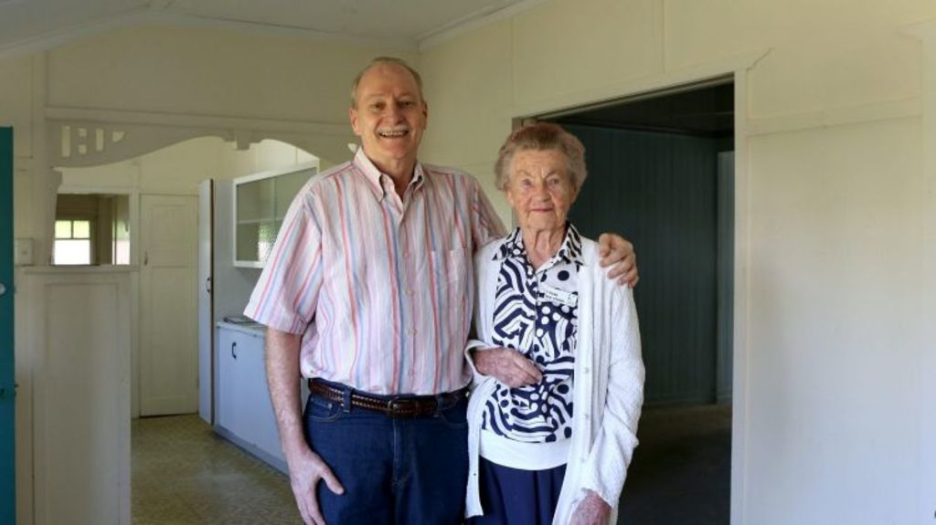 John Rogers and his 92-year-old mother Robin Rogers stand in the family dining room. Photo: Michelle Smith