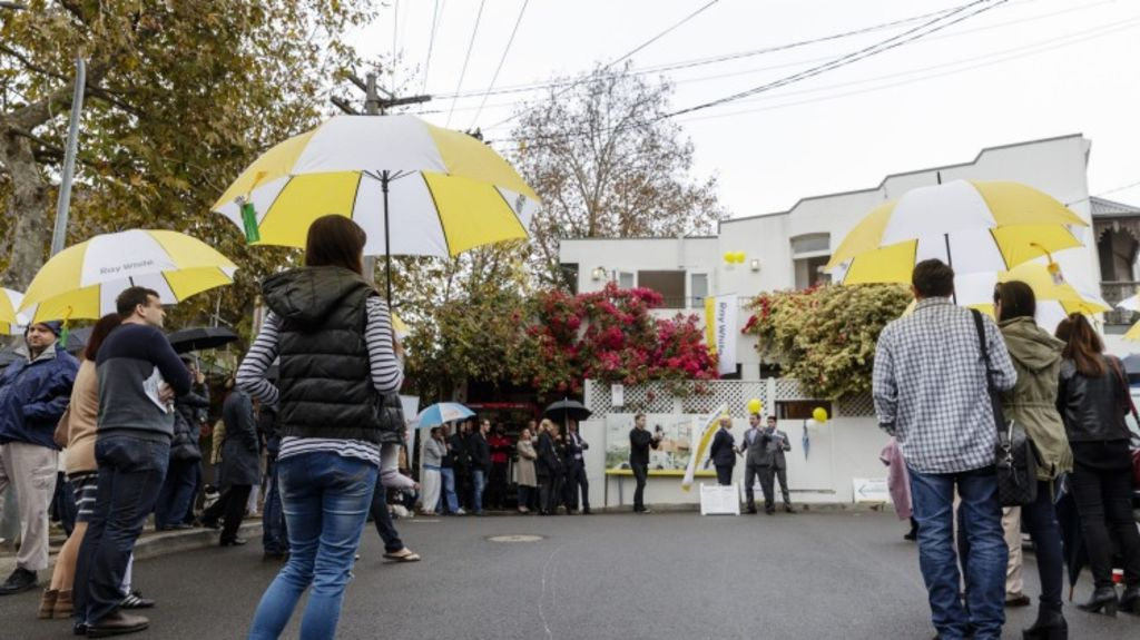 Crowds gather on a rainy morning for the auction of 17 Elfred Street in Paddington. Photo: Brook Mitchell