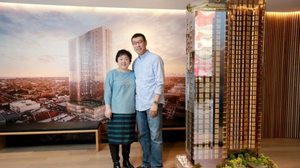 Buyers like Yanming Shen and wife Hong Qu are drawn to apartments in the inner-city of Box Hill and are happy to spend money for views across suburbia. Photo: Wayne Taylor