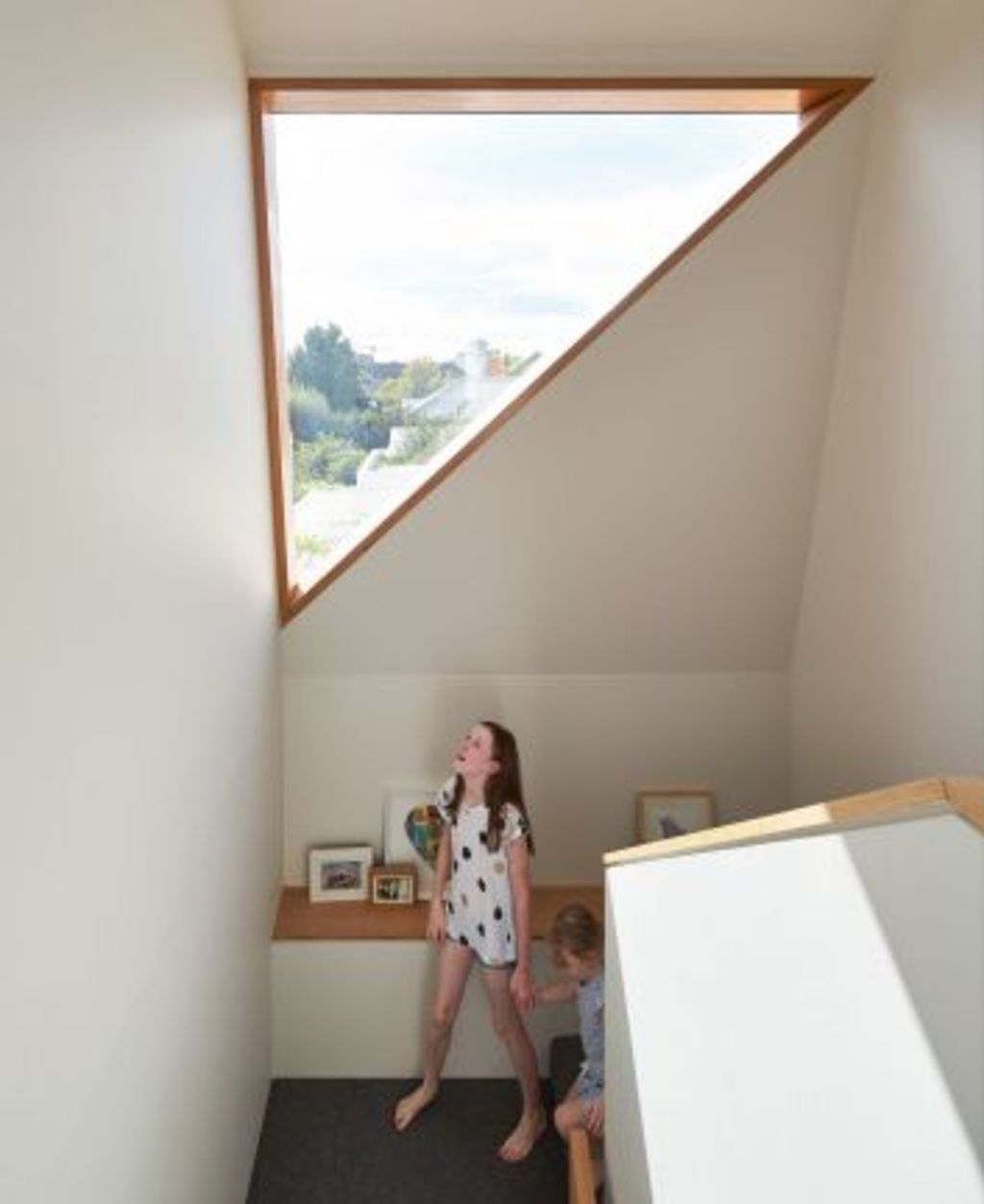 A little seat on the stair landing creates a safe haven. Photo: Peter Bennetts