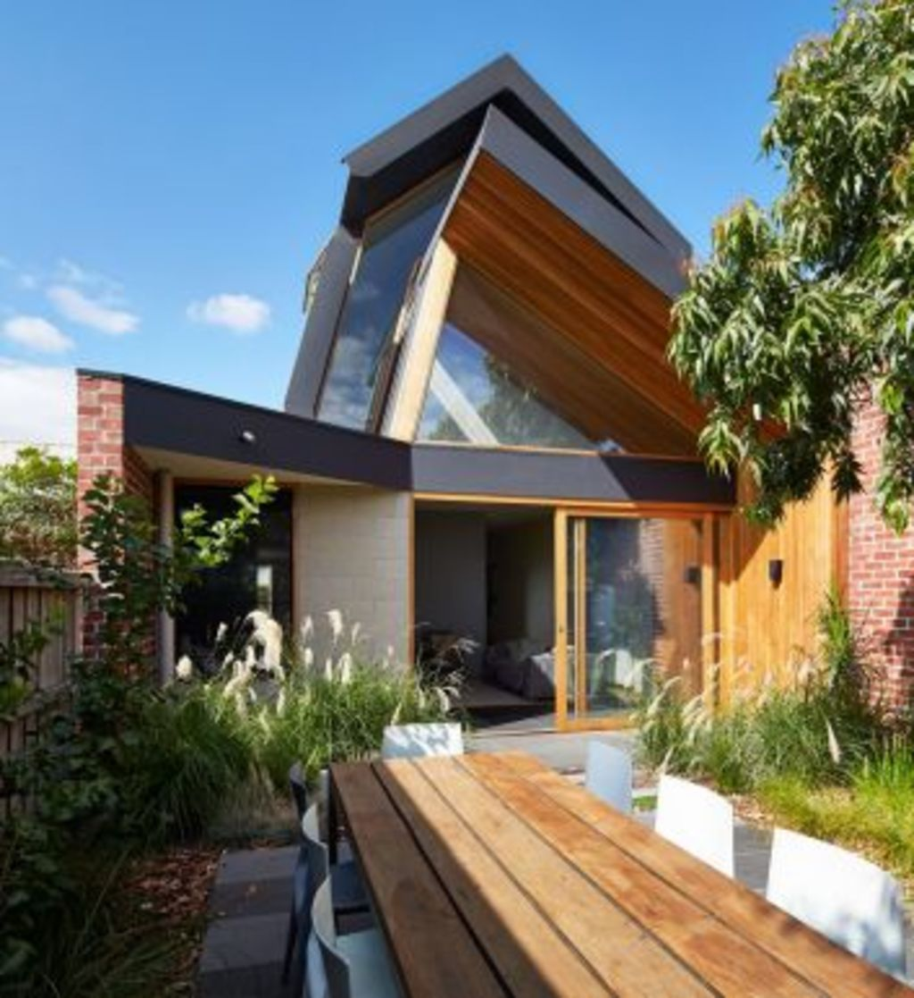 Angled up to catch the sun, the roof design also had to fit into council restrictions. Photo: Peter Bennetts