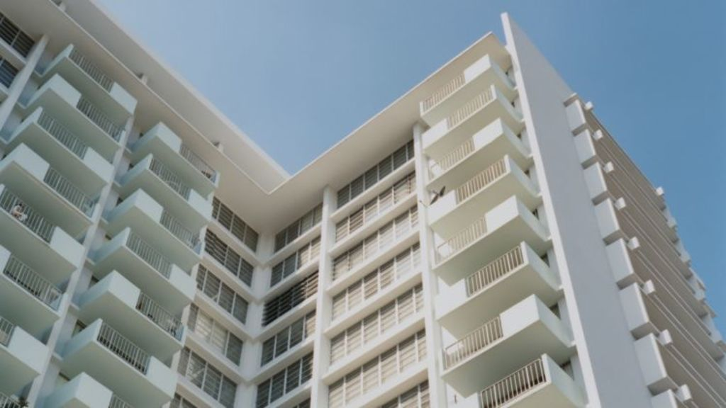 Before moving in, consider the cons of high-rise living. Photo: Stocksy, Paul Edmondson