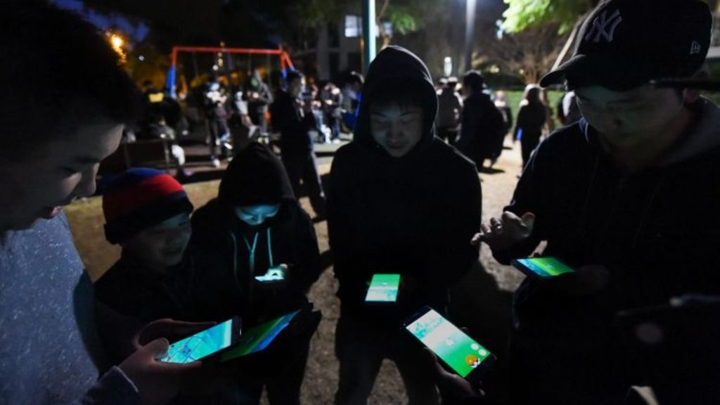 Pokemon Go players in Peg Paterson Park, Rhodes. Photo: Mark Jesser