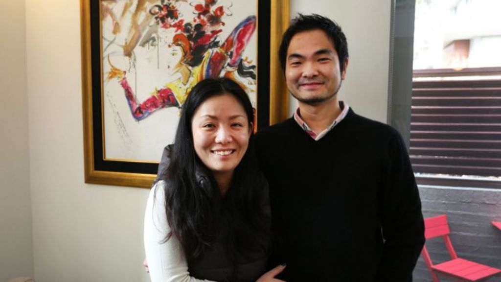 First home buyers, Shoko  and Kenlee,  after their winning bid of $925,000. Photo: Kirk Gilmour