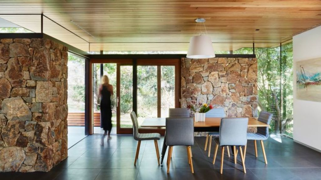 Natural materials: Bluestone tiles adorn the dining room of the Doncaster house, renovated by Steffen Welsch Architects. Photo: Rhiannon Slatter